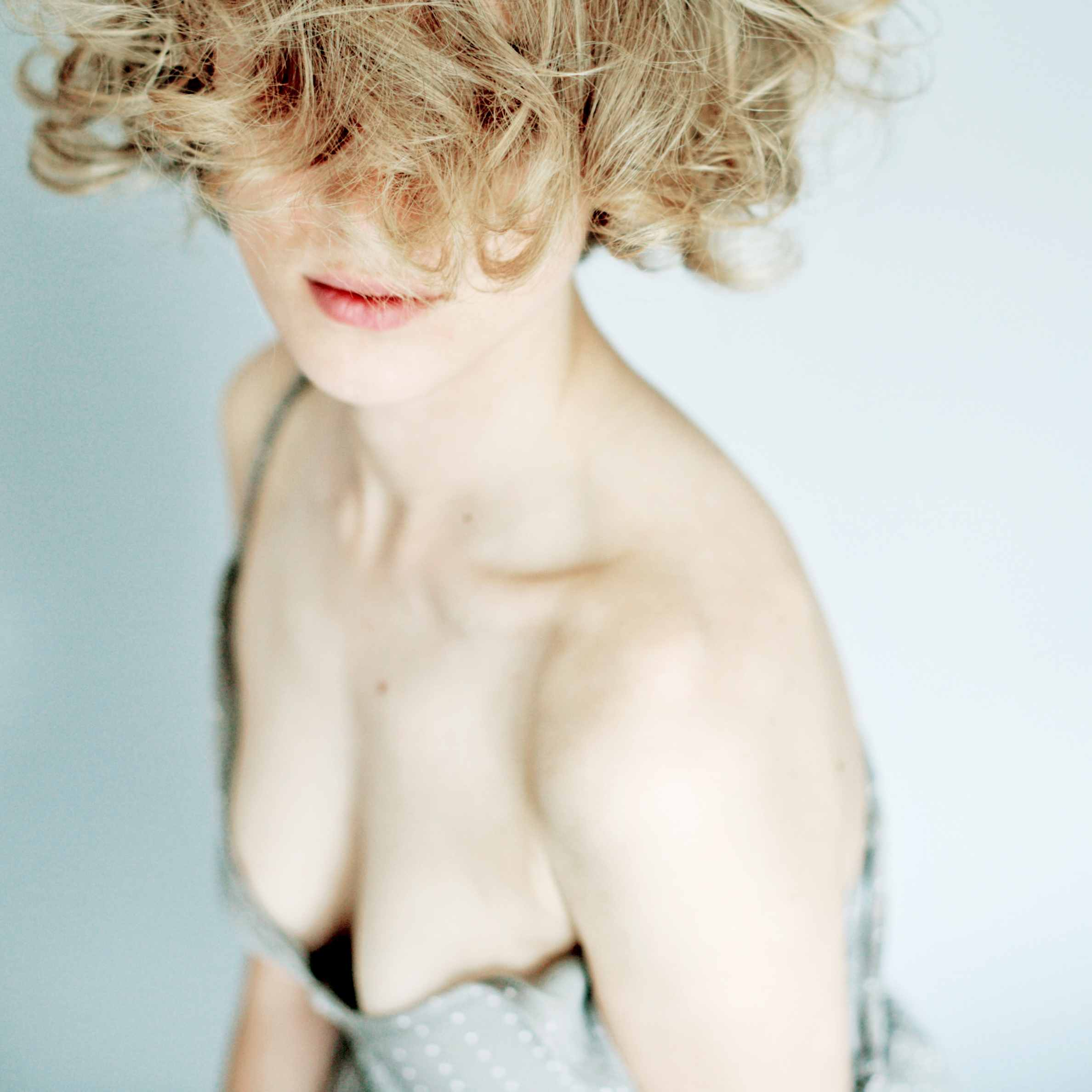 White woman with blonde curls