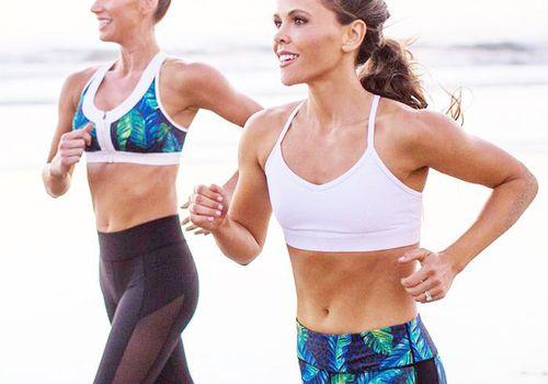 women running on a beach
