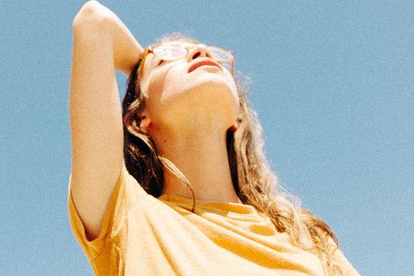 woman looking up at sky