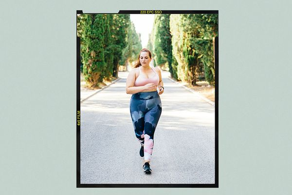 woman running down street