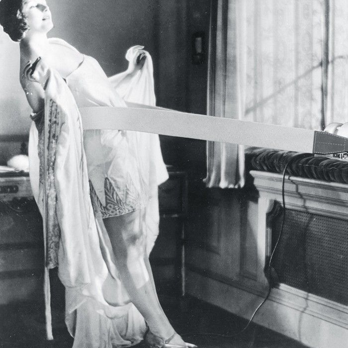 A woman from the 1900s to 1920's in a minimal effort workout machine