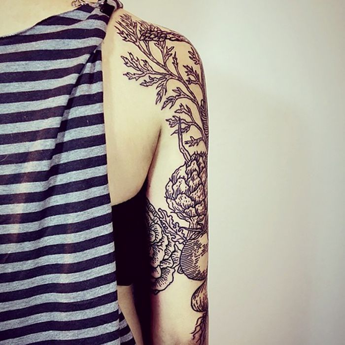 Minimalist black and white plant tattoo sleeve