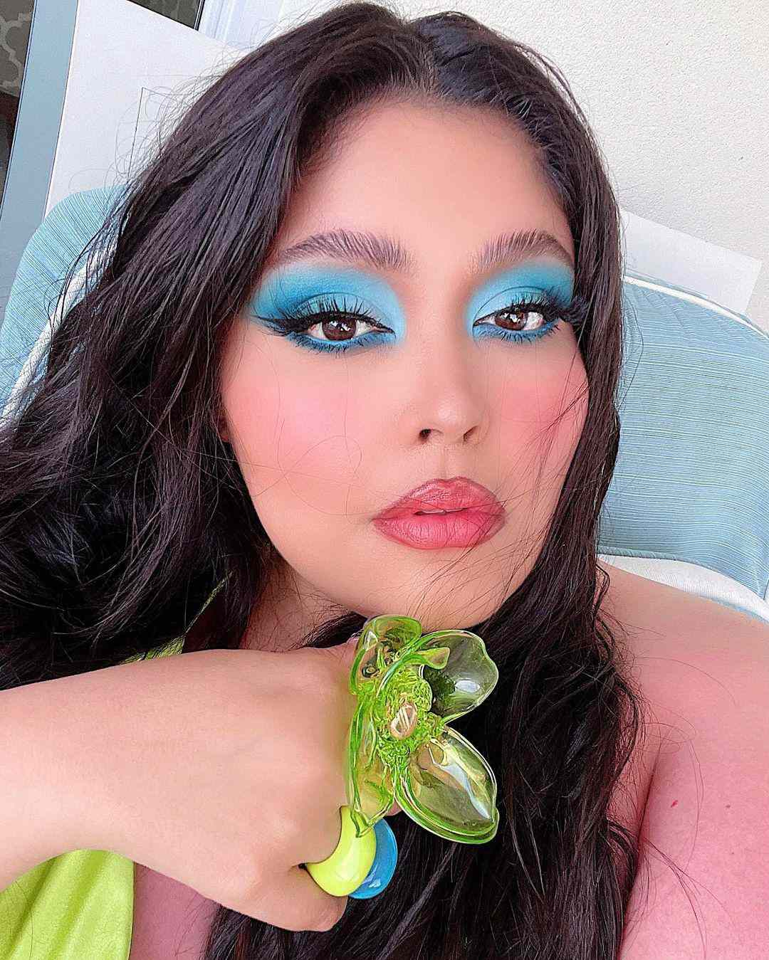 Woman with blue eyeshadow and liner