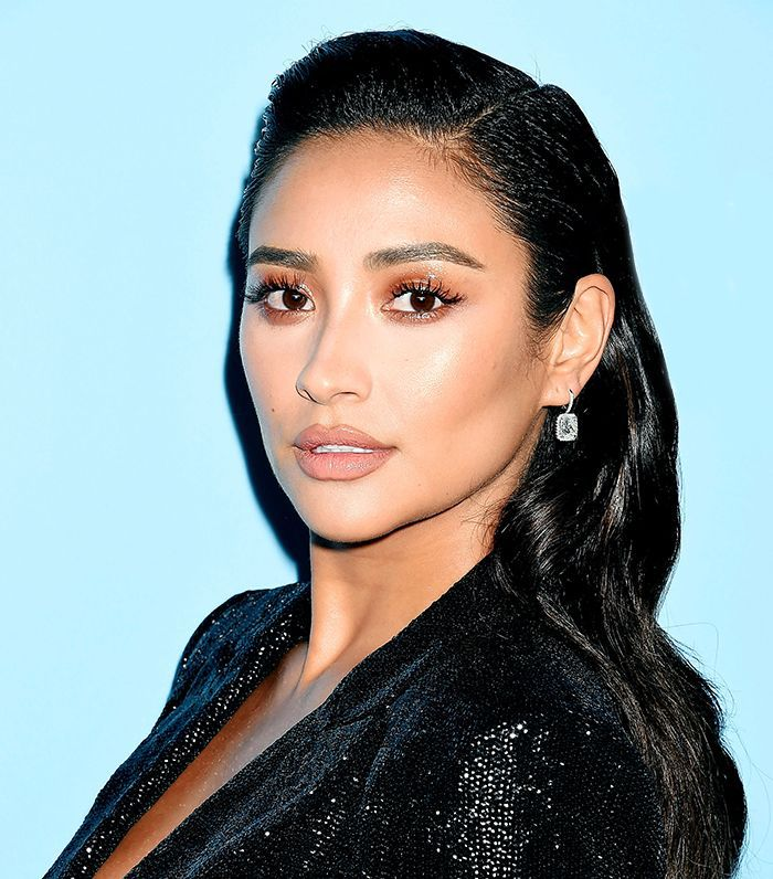 Shay Mitchell with her hair styled in sleek, Old Hollywood waves