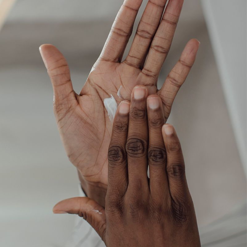 closeup of hands spreading lotion