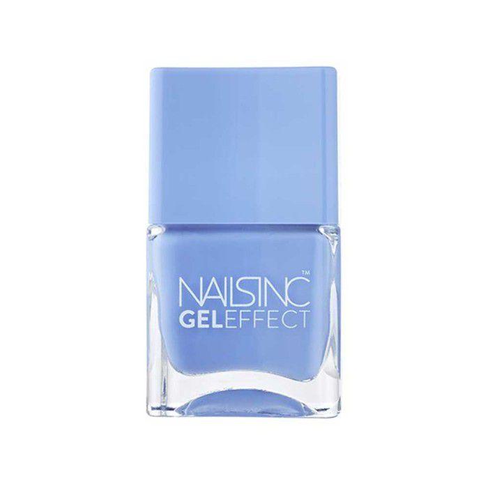 Bottle of baby blue nail polish on a white background.