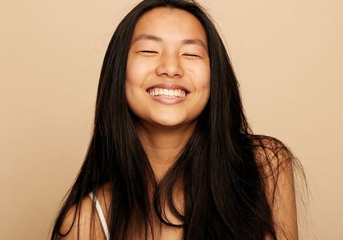 woman smiling with beautiful clear skin