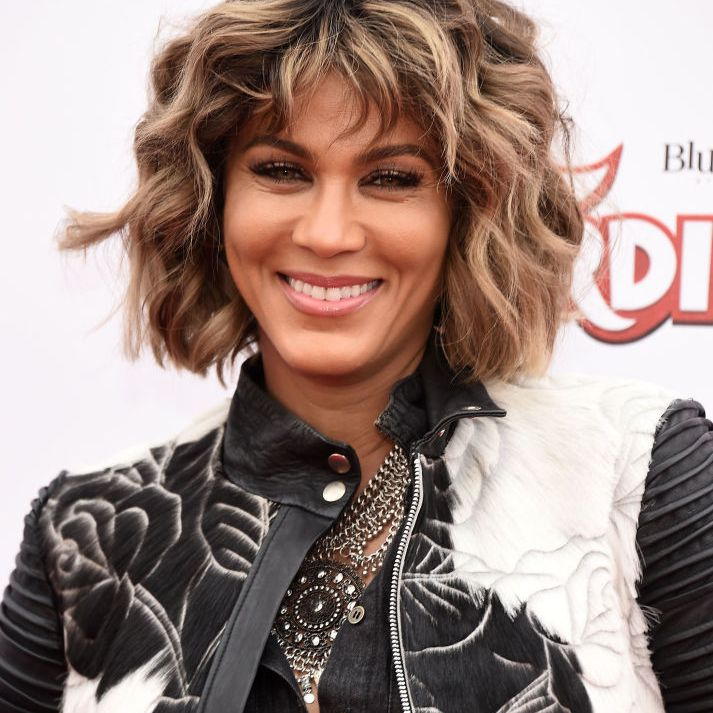 Nicole Ari Parker curly bob with bangs