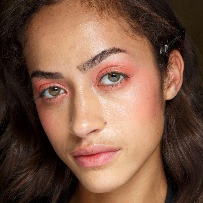 Model wearing peachy eyeshadow