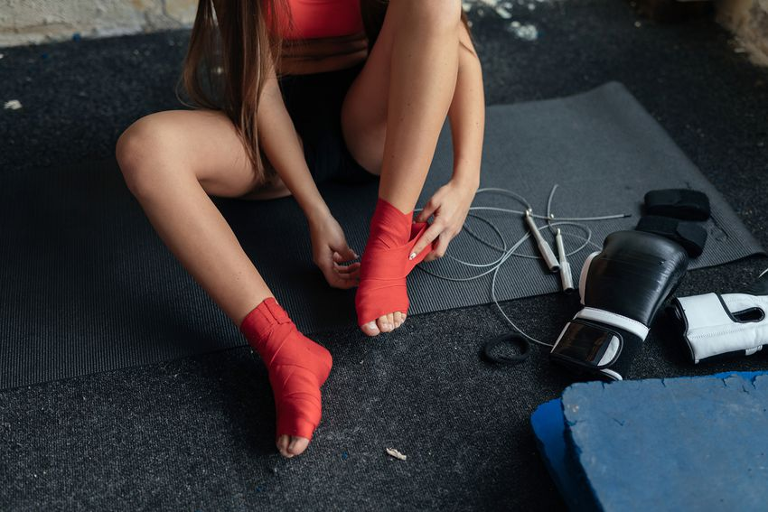 Kickboxing girl getting ready for training.