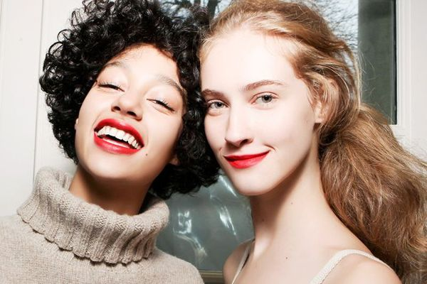 Two woman, blonde and brunette, with red lips