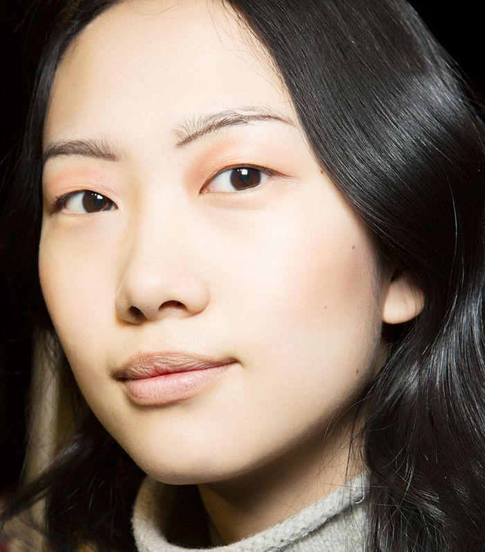 Model wearing a soft rose gold shade on eyelids