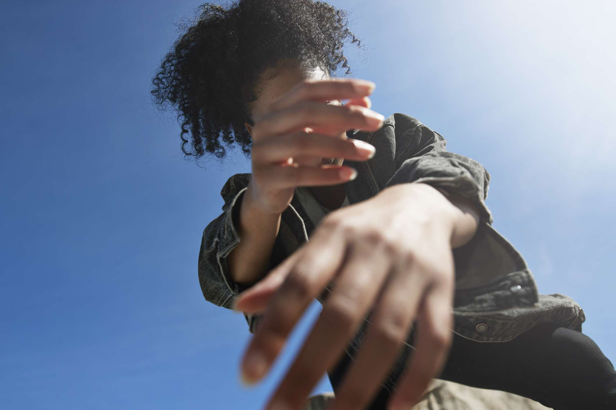 woman with curly hair in the sun