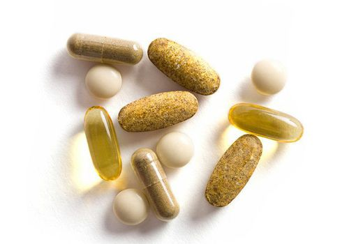 an assortment of brown and white vitamins