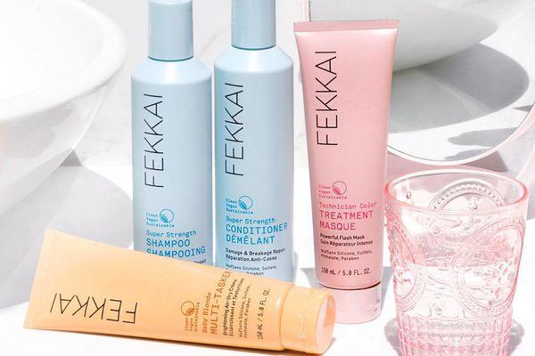 Fekkai shampoo, conditioner, treatment masque and dry cream on a bathroom sink.