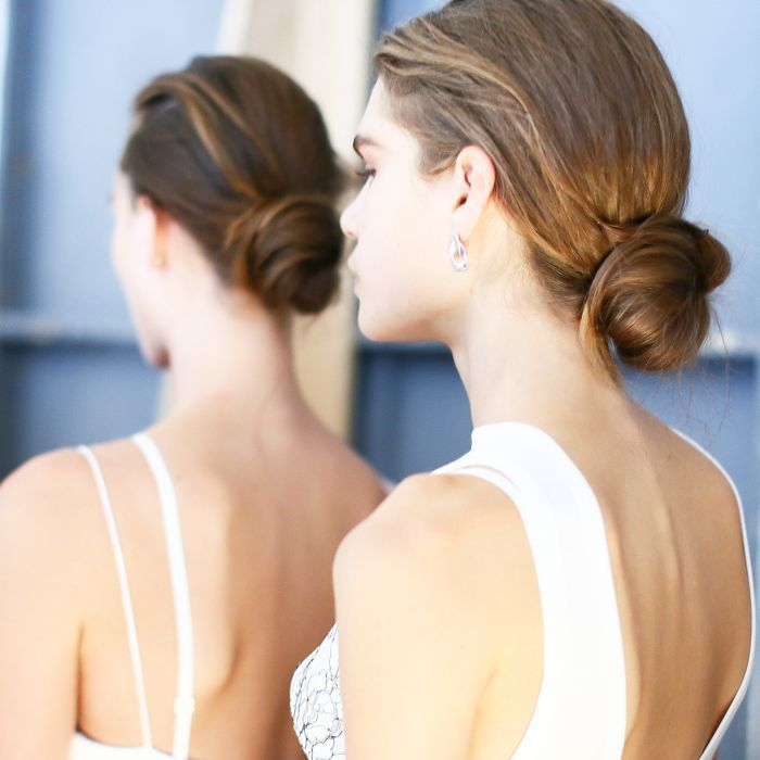 Model with hair pulled back into low bun