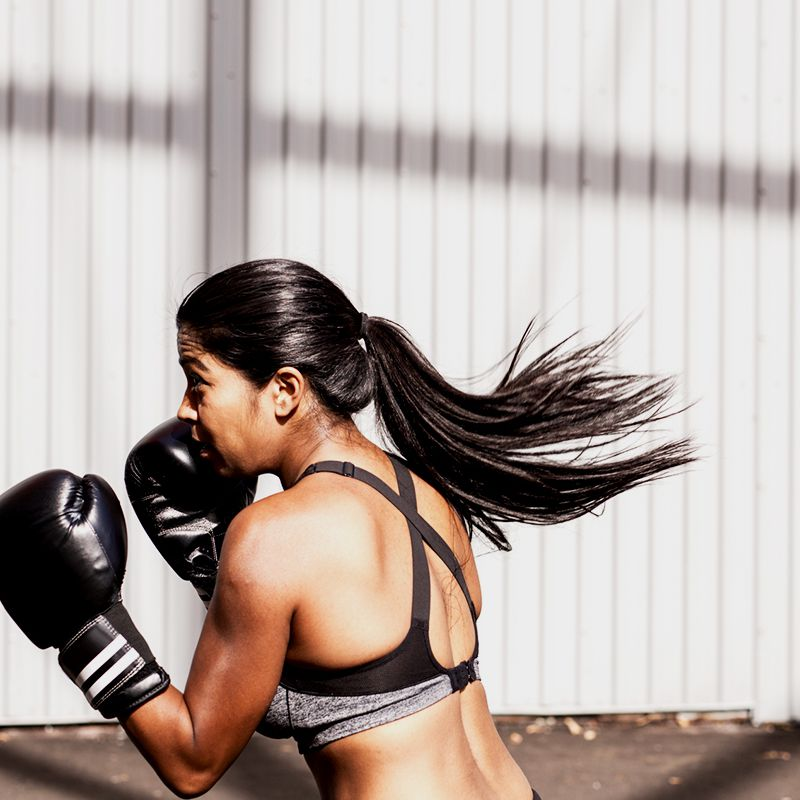 person kick boxing in the sun
