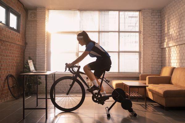 Woman cycling at home