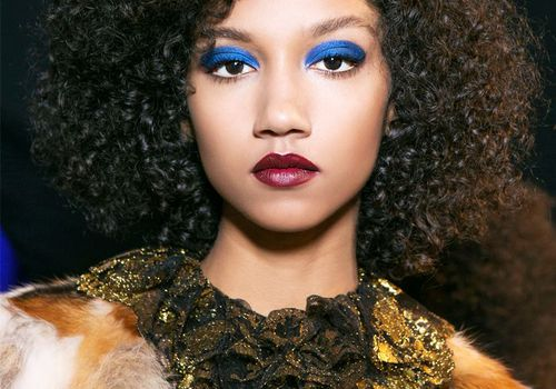 woman with blue eyeshadow and dark red lipstick