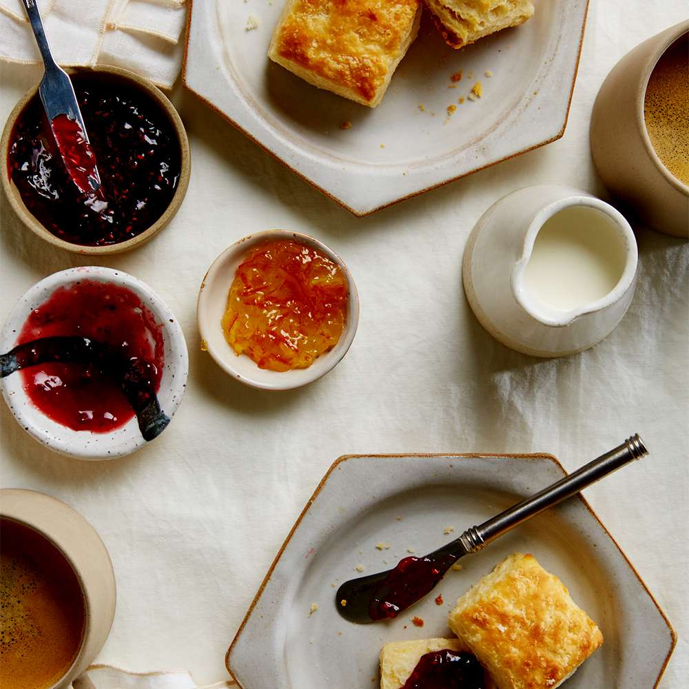 table set with biscuits and jam