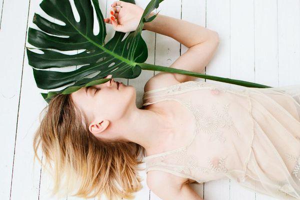 woman holding a palm leaf