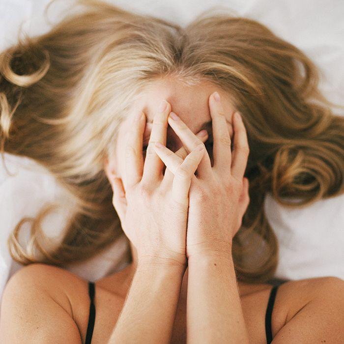 Elixseri skin meditation serum review: woman hiding her face