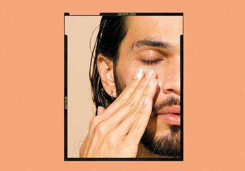 Man applying skincare products