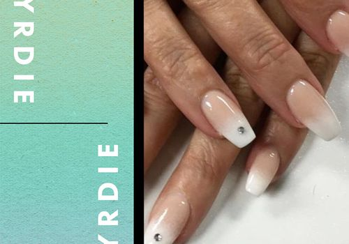 french ombre nails with sparkle gem