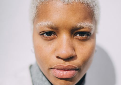 brown skinned person with bleached brows and hair
