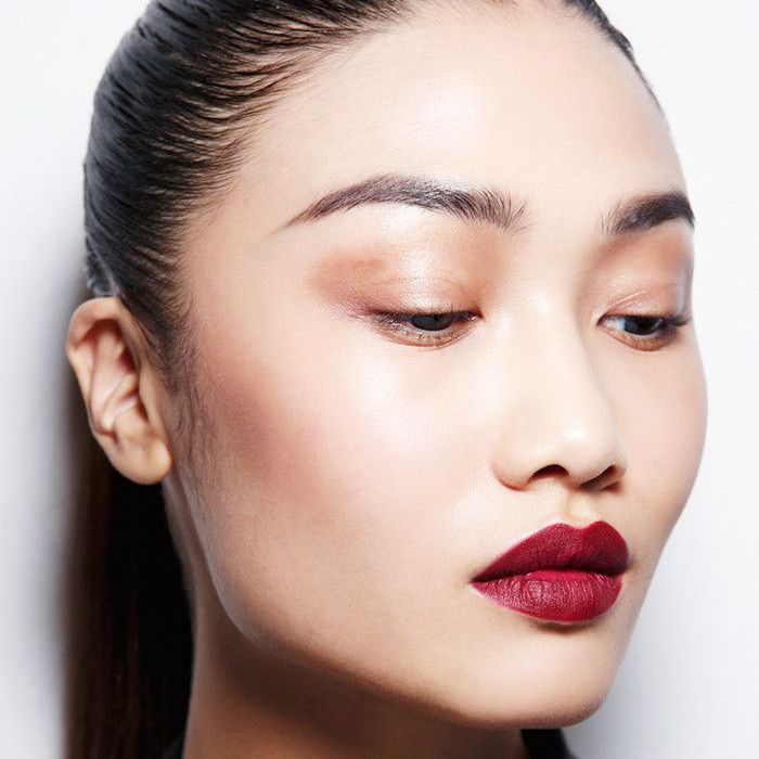 woman wearing dark red lipstick
