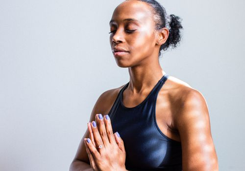 woman meditating in sports bra