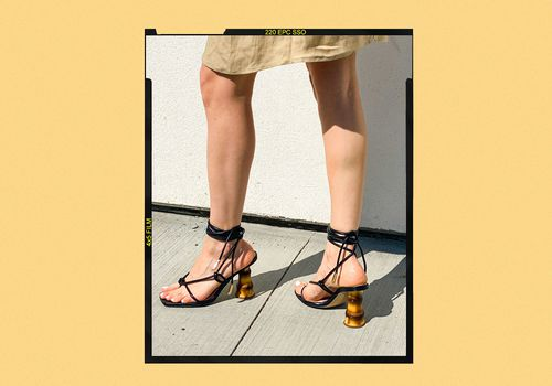 Woman Wearing Black Sandals