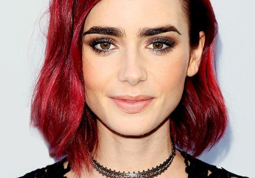 dark red hair colour: Lily Collins with cherry red hair
