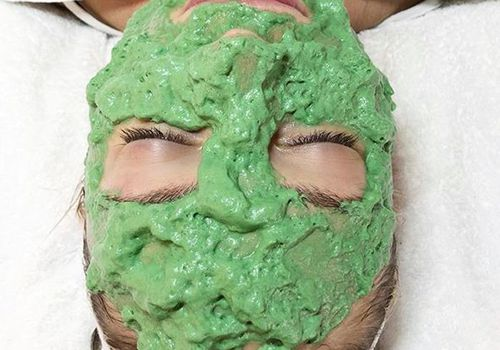 woman lying down with face mask