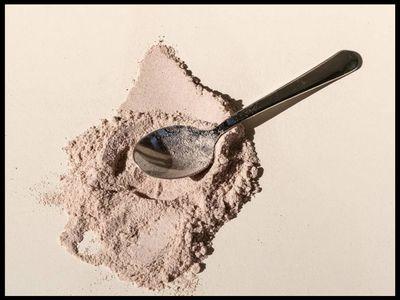 whey protein powder on a spoon
