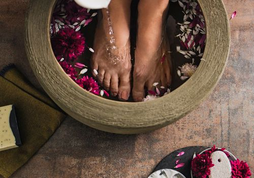 Woman with wooden foot bath