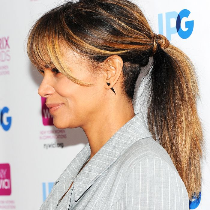 Halle Berry with her hair in a messy ponytail