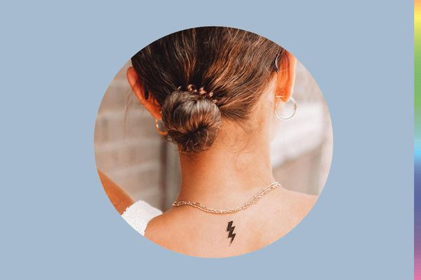 woman with lightning bolt temporary tattoo