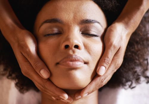 Black woman having a head massage