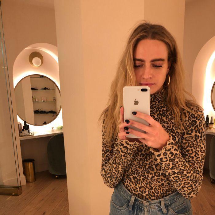 Hallie G. taking a selfie to check concealer