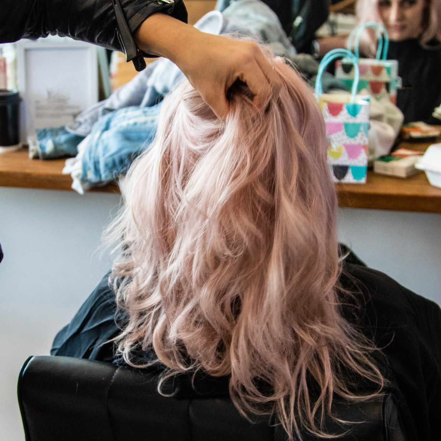 Woman sitting in chair at hair salon