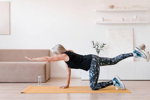 woman performing a bird dog exercise