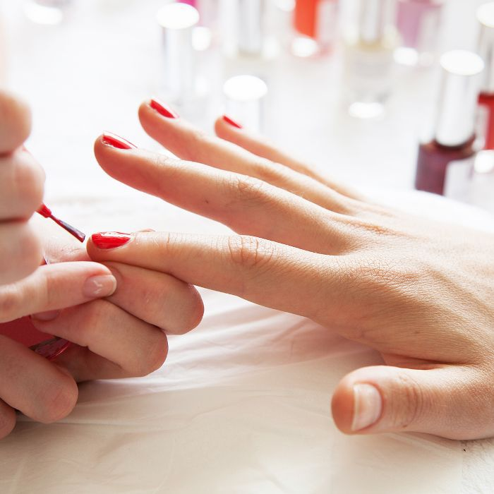 Fingernails being painted