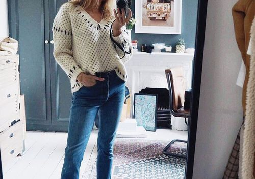 woman takes a selfie in the mirror