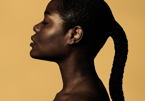 woman with glowing skin and braid