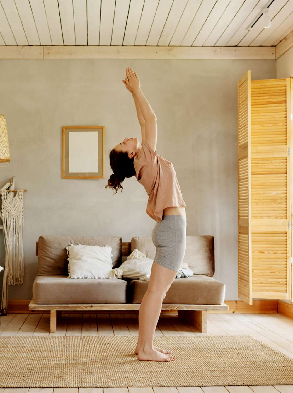 person doing sun salutation at home