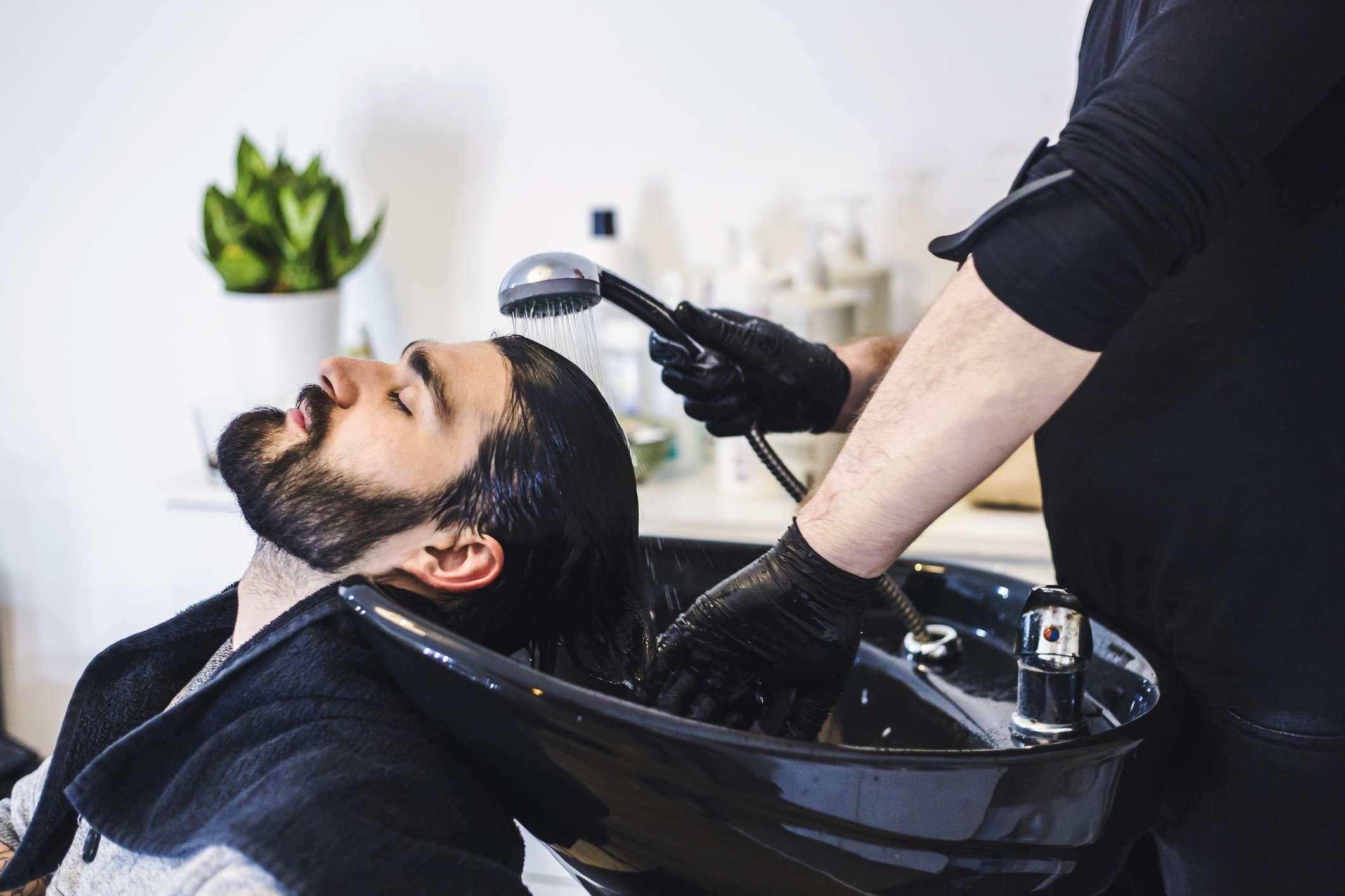 Man having his hair washed at a salon