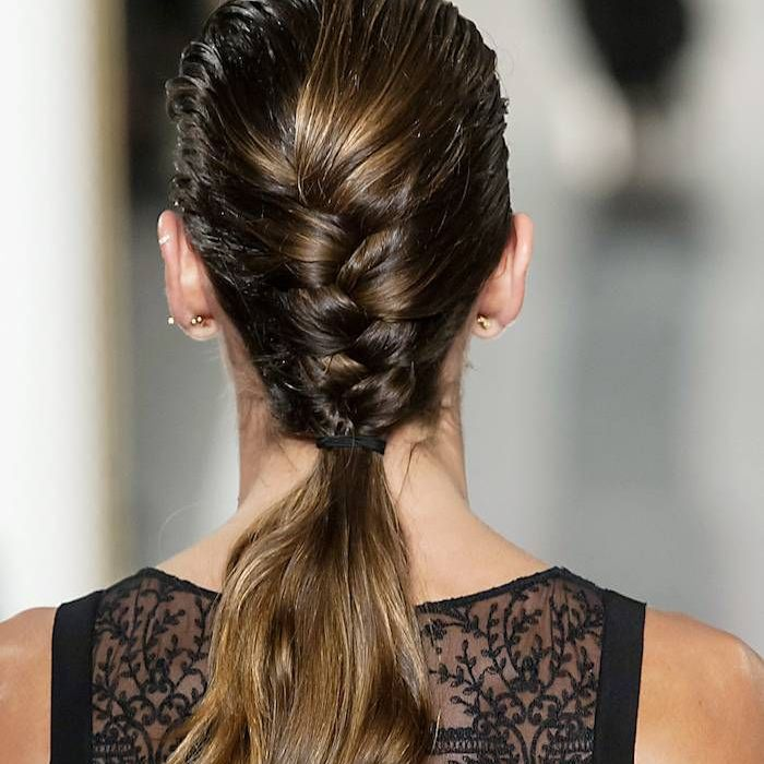 Woman with her hair in a braid with loose ends