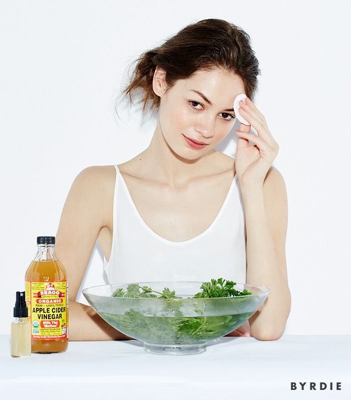 model with bowl of herbs in water, spray bottle, and apple cider vinegar, patting face with cotton round