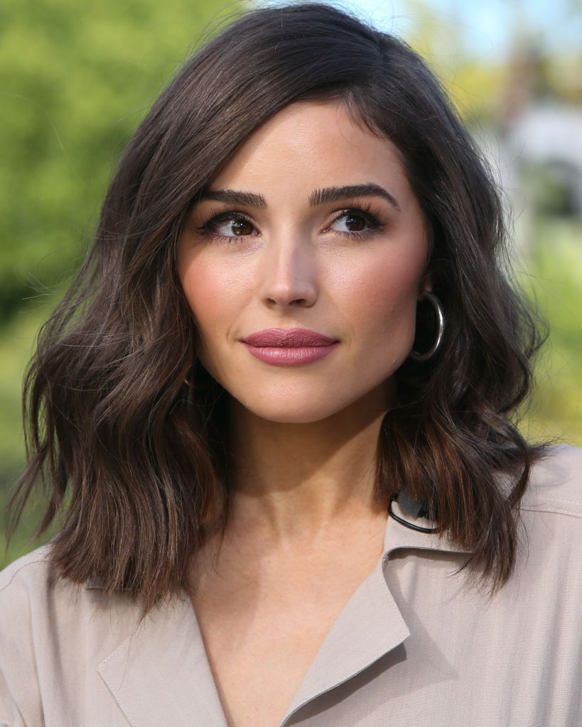 Olivia Culpo wavy lob with side part and blunt ends